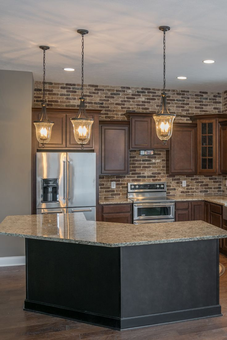 Embarcadero thin brick made by McNear. This homeowner went with a fantastic interior thin brick application that runs from her kitchen as a backsplash and through her adjacent dining room.