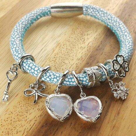 Wrap leather bracelet one loop price at 10usd only and variety of charm cubic,pearl,birthstone staring at 1.5usd only...