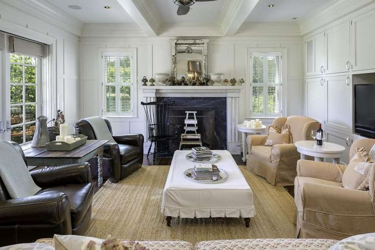 Light-filled rooms in the farmhouse have wide moldings, wainscoting, coffered wall paneling and multipane windows. The great room has a Rumford fireplace with stone surround,…
