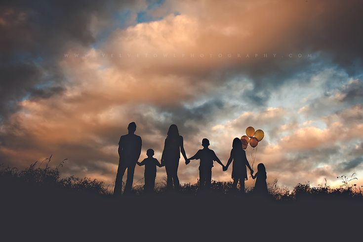 such a beautiful family silhouette photo and great use of balloons, love it - photo by VeLvet OwL Photography