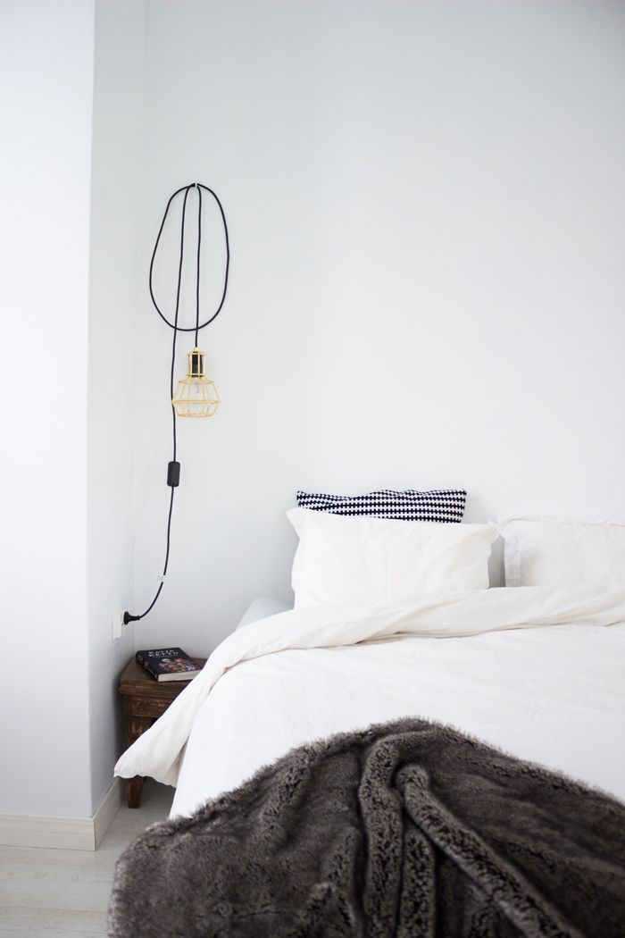 Scandinavian home, Design House Stockholm Work lamp gold, furry blanket / www.livinupanotch.com