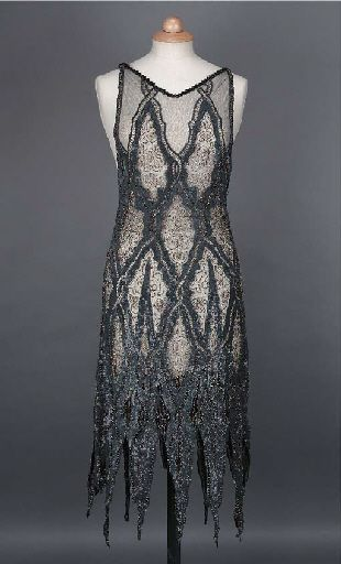 A cocktail dress, the black net ground applied with grey and black sequins in diaper pattern, with sharply jagged hemline, 1920s