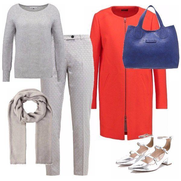Pantaloni grigio chiaro a pois e maglioncino dello stesso colore dai toni molto soft, abbinati a una sciarpa grigia e a scarpe argentate con un po' di tacco. Il tutto abbinato a un cappottino primaverile di colore acceso e reso ancora più colorato dalla borsa blu.
