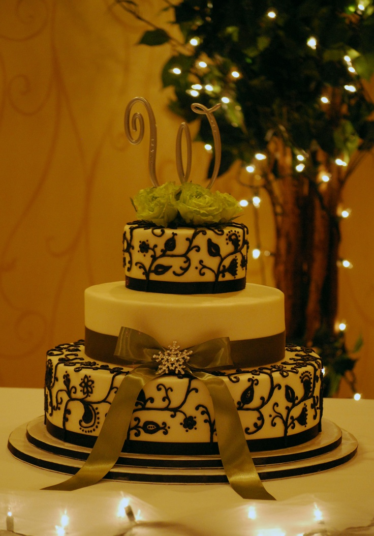 3 tiered oval wedding cake with modern style scroll piping, green ribbon & bow and bling ...... toptierweddingcakes.dotphoto.com