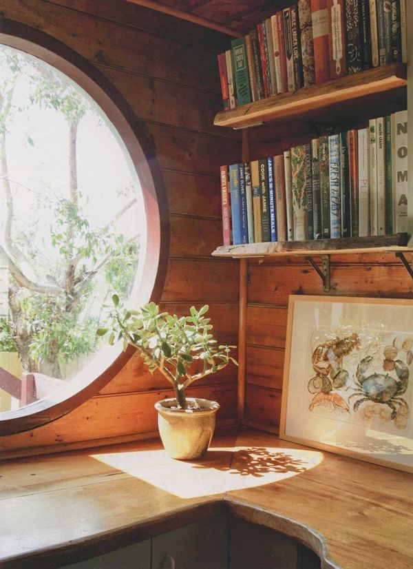 round window, kitchen nook with books? Very hobbity
