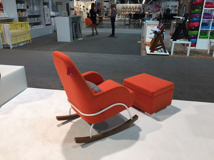 A statement piece for your nursery! The Jackson Rocker shown here in orange with our new white steel base option and Storage Ottoman. #ABCKidsExpo16