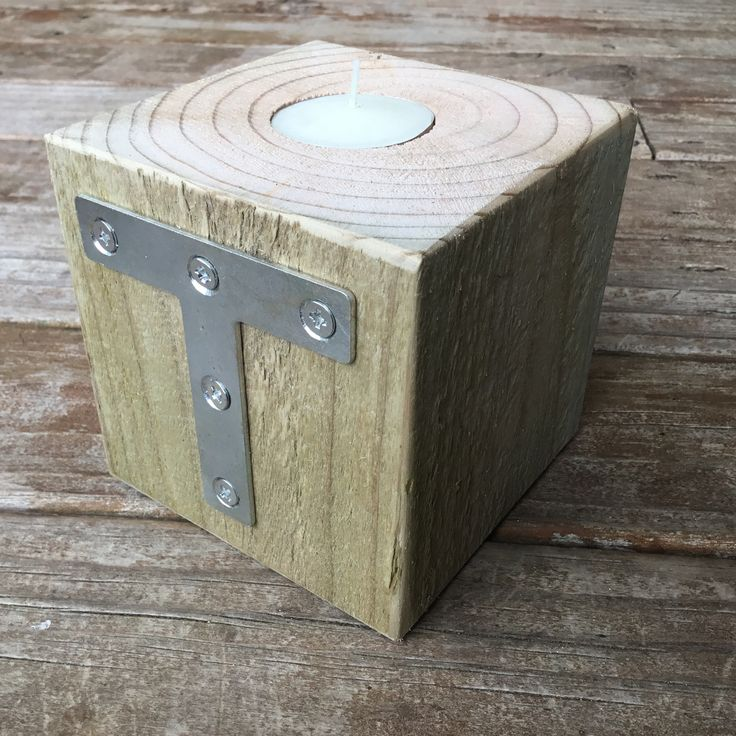 "Used an off cut of 4"" x 4"" tanalised pine, found a T bracket at the hardware store - T for Tea light !"