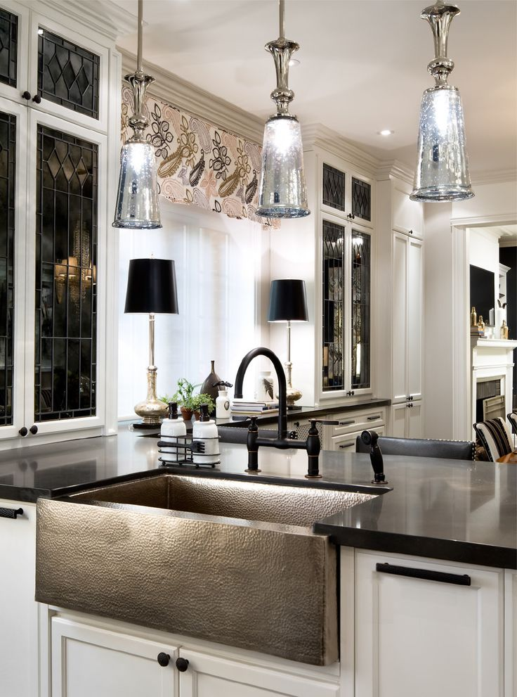 Candice selected an outstanding antique silver finish to add a regal touch to the room.  She made excellent use of Corbett Lighting's Argento one-light pendant, which she smartly hung in multiples over the bar counter.