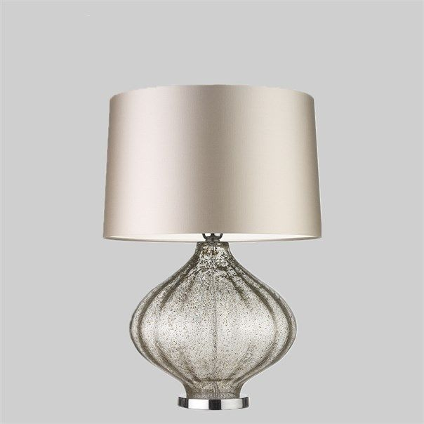 The Fiametta lamp is an elegantly curved mould blown glass piece with a subtle optic texture. The soft opacity and flecks of gold leaf interlaced between layers of glass make this lamp an object of beauty. This design is individually crafted and will vary from piece to piece; providing a unique and timeless product.