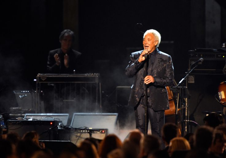 Tom Jones Photos Photos - Singer Tom Jones onstage at the 25th anniversary MusiCares 2015 Person Of The Year Gala honoring Bob Dylan at the Los Angeles Convention Center on February 6, 2015 in Los Angeles, California. The annual benefit raises critical funds for MusiCares' Emergency Financial Assistance and Addiction Recovery programs. - The 2015 MusiCares Person Of The Year Gala Honoring Bob Dylan - Show