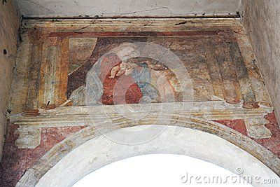 Medieval fresco on a wall in Treviso city, Italy, Europe.