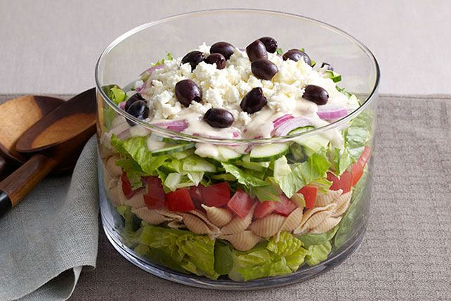 This layered Greek salad is ideal for a potluck, where everyone can get a piece of the creamy, cheesy, spinachy, olive-studded action.