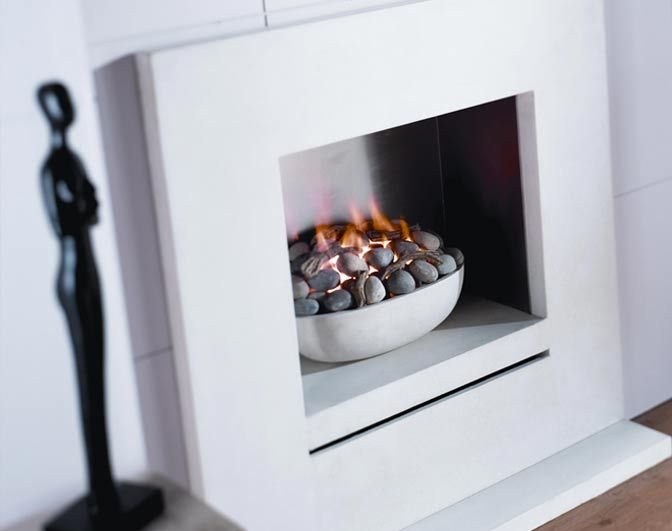 Palladio - A simple hole in the wall fire. with a bowl cast in a monolithic style.