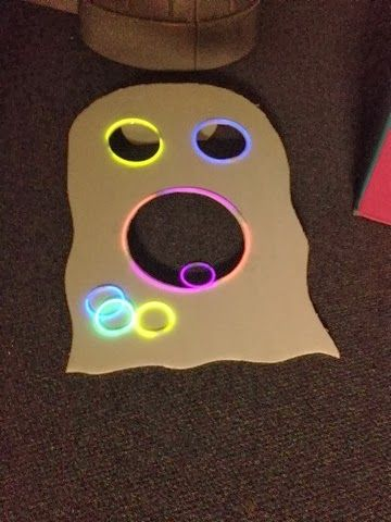 Glow in the dark ghost ring toss. Gross motor - Adventures in Preschool