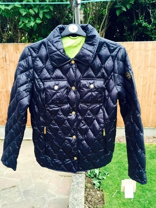 SALE! Michael Kors packable jacket - RRP £300, now £138!  Size M (UK 12-14) Downfill diamond quilted jacket by Michael Kors - brand new with tags!  Comes with its own duffel bag to roll up and keep safely tucked away in handbags or luggage. Super lightweight but lovely and warm - it's perfect for throwing on and looking stylish!  Selling to UK buyers - but if you're international, let me know and I'll make arrangements!