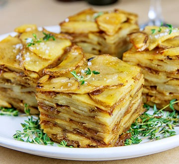 Pommes Boulangere: Ingredients 1 tablespoon olive oil 6 large Idaho potatoes, peeled