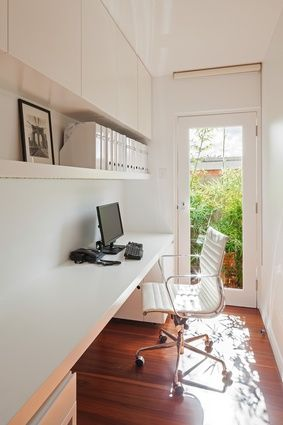 Natural light filters into the study space, with a glazed door offering views of greenery and leading out to a garden.