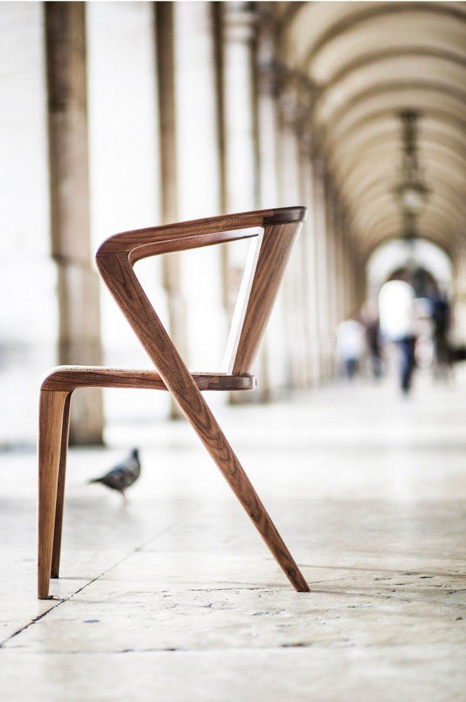 #chair with armrests PORTUGUESE ROOTS by AROUNDtheTREE | #design Alexandre Caldas. Plain a simple yet very different. Also really like the wood.