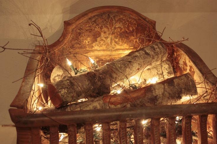 This gives me ideas for the fireplace in summer -- A few pretty logs and a string of lights...