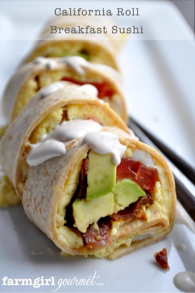California Roll Breakfast Sushi - rolled up tortilla stuffed with bacon, eggs, cheese, tomato, avacodo; topped with a spicy sour cream.