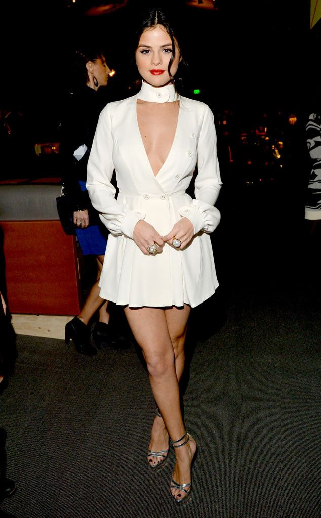 Elegance from Selena Gomez's Best Looks Selena slips into a plunging, long-sleeve mini Ulyana Sergeenko dress with strappy Charlotte Olympia sandals.