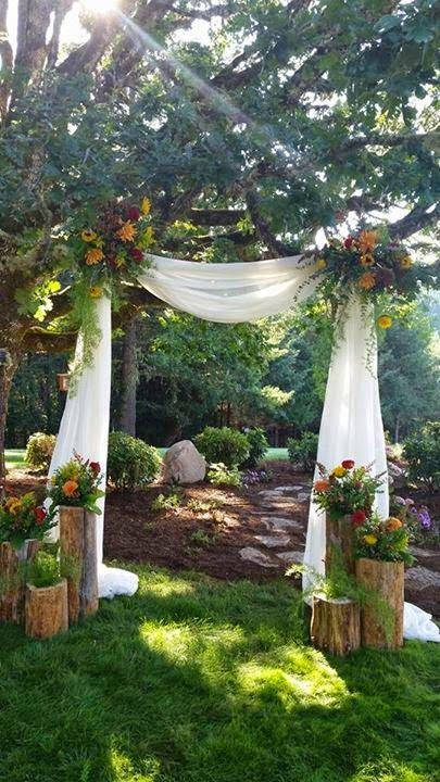 Back yard ceremony setting by Savvy Sisters Inc.