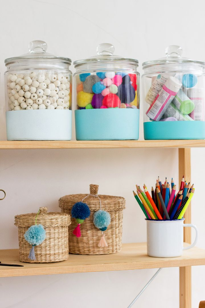Get organized with our DIY glass storage jars! These are easy to do and make the best jars for craft supplies. They would be great for the kitchen too!