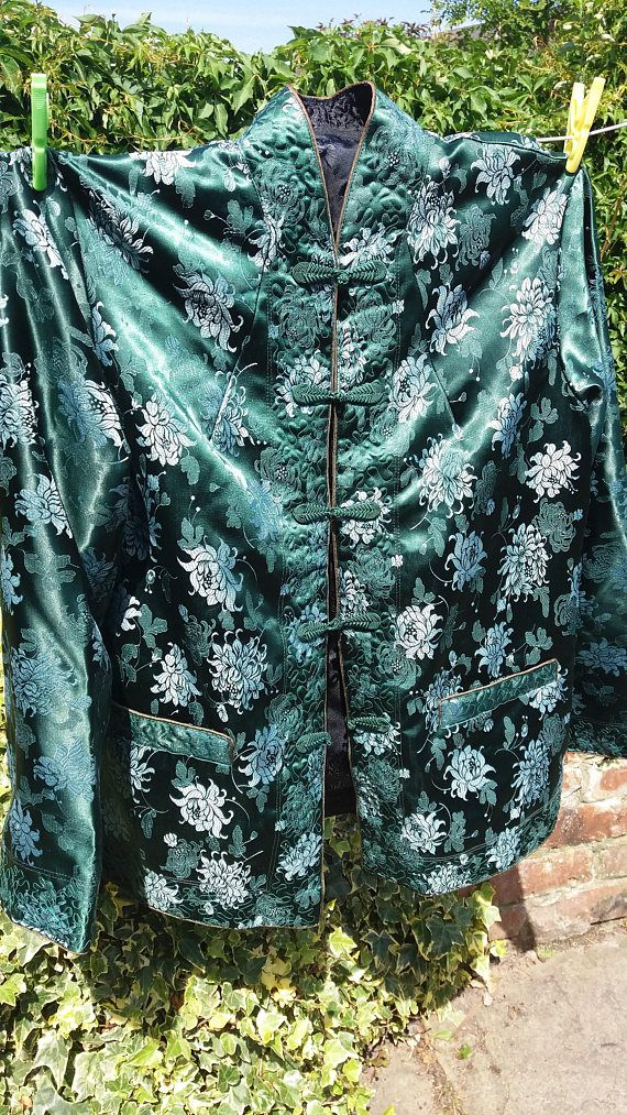 This is a gorgeous jacket which I am selling because it doesnt fit me sadly. It is wonderful condition and probably not been worn. Its a beautiful green colour with silver brocading. It fastens with little frog fasteners and can be reversed. It black brocaded on the inside.  It measures 22 inches armpit to armpit and is 26 Inches long.  Please ask if you have any questions