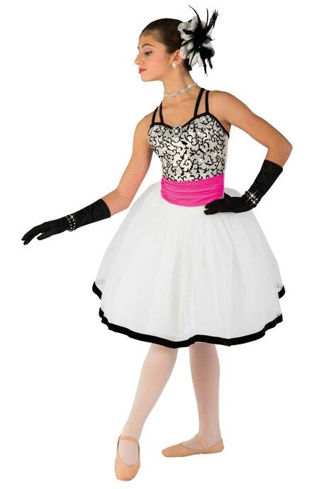 White lycra leotard with flocked sequin mesh overlay and attached flo-hot pink lycra sash. Separate white tricot euro tutu AND black boa skirt on elastic waistband. Jewel brooch and velvet ribbon trim.  Faux rhinestone tiara