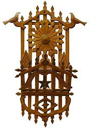 This is a beautiful tramp art magazine rack, decorated with birds on free-form branches and dated 1927.
