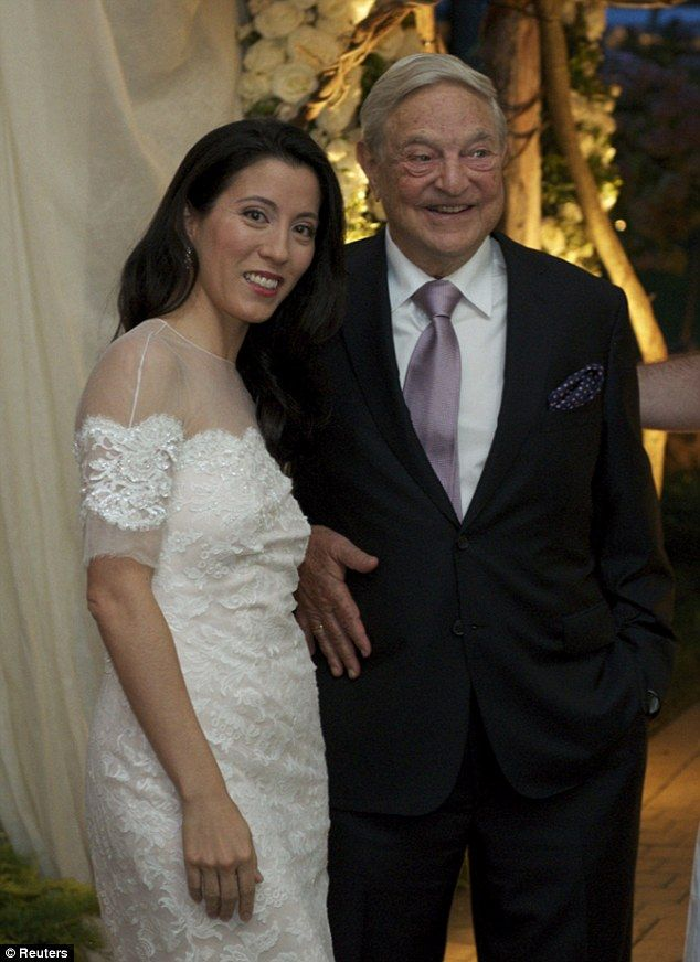 Just married: George Soros, 83, and his new bride, Tamiko Bolton, 42, at their wedding in Bedford, New York, on Saturday                  #### Lets hope she speeds up his journey to his  after-life , which will be very hot.