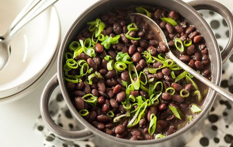 Concentrating the bright flavor of green onions, fresh garlic and dry white wine is the key to this ideal pot of black beans. Spoon over rice or expand with vegetables and broth to make a soup.