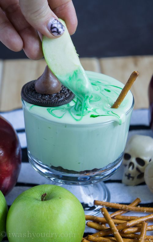 Melted Witch (chocolate chip cream cheese) Fruit Dip Recipe ~ the PERFECT dip to have at your Halloween Party! It's super easy and quick to make, it tastes PHENOMENAL, and everyone will get a kick out of it!