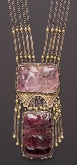 Arts & Crafts Carved Gem-set Necklace, J. Hartwell Shaw, composed of multiple strands of fancy link chain suspending bezel-set rose quartz and purple tourmaline tablets enhanced by flexible fringe, applied bead accents, completed by a conforming beaded clasp, gold, silver and silver gilt mount, lg. 271/2 and 31/2 in., signed J.H. Shaw, (missing one fringe). Note: Shaw (active 1900-1935) was from Duxbury, Massachusetts. Her work is represented in the Boston Museum of Fine ...