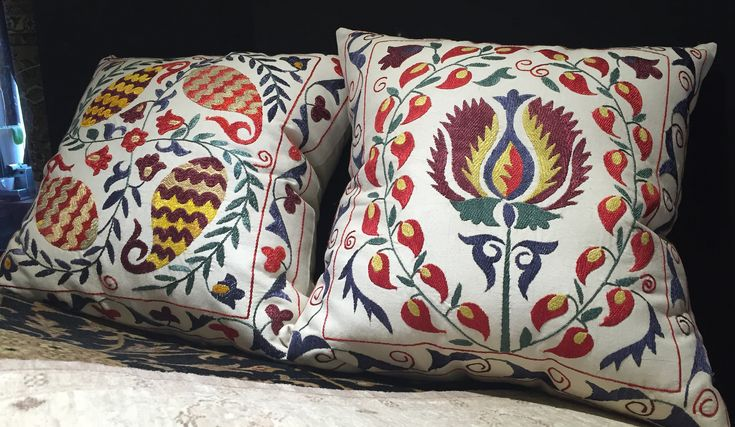 pair of hand crafted cushions
