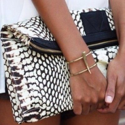 I love this black and white snakeskin clutch that is just soft enough to fold over making it easy enough to carry and giving it a more relaxed and hip look then some of the stiff clutches we've seen! This gold bangle is a wearable work of art- so cool!  |Fold & Hold Foldover Clutches|