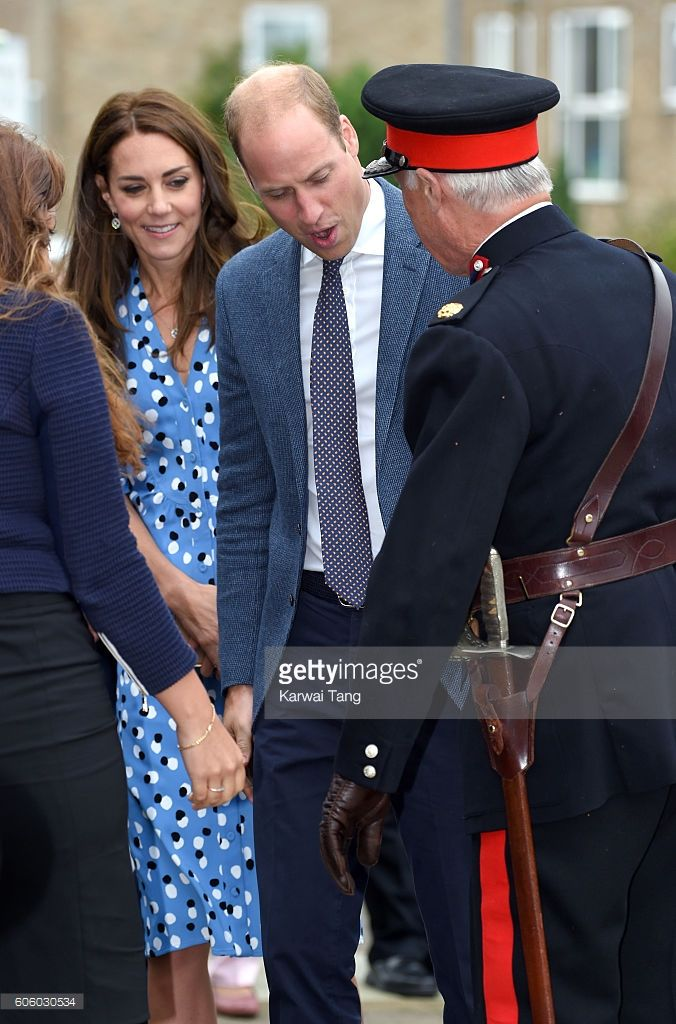 Catherine, Duchess of Cambridge and Prince William, Duke of Cambridge check on Vice Lord Lieutenant of Essex Jonathon Douglas-Hughes after he fell over a bollard during the visit of Stewards Academy with HeadsTogether on September 16, 2016 in Harlow, England.