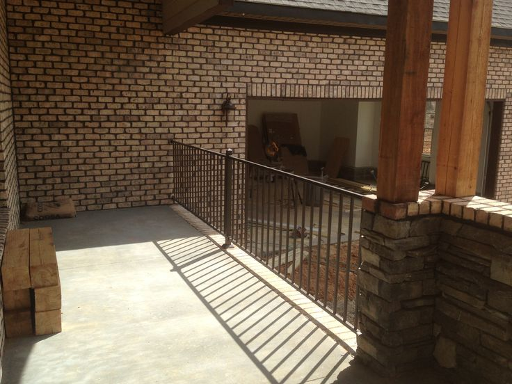 Front porch with Fortress aluminum handrail and cedar columns, bead board ceilings, and hardie siding