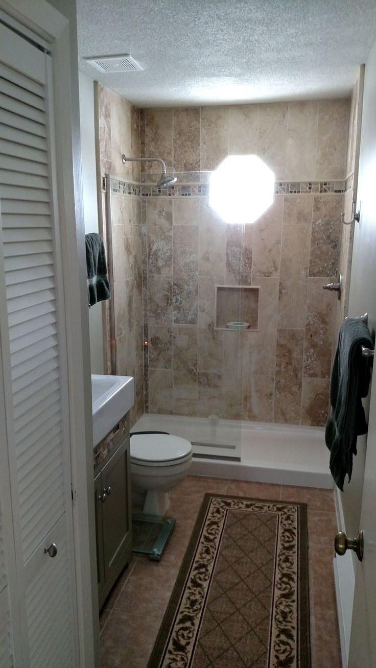 Best 25 replace tub with shower ideas on pinterest cleaning travertine marble tile in vertical pattern refinished vanity with new ceramic top new hooks and bars new octagonal mirror to replace dailygadgetfo Image collections