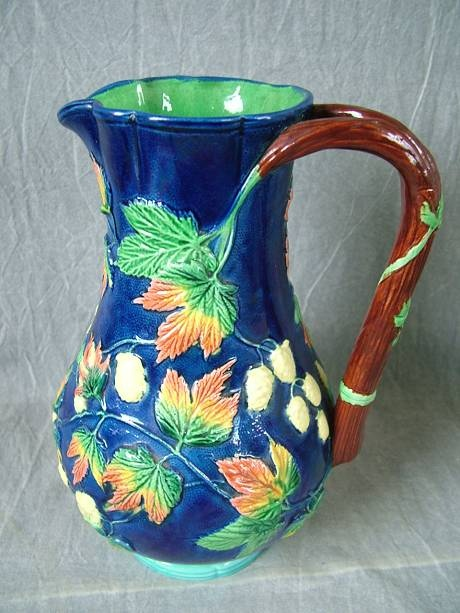 Pottery With Painted Blue And Green Berries On Rim