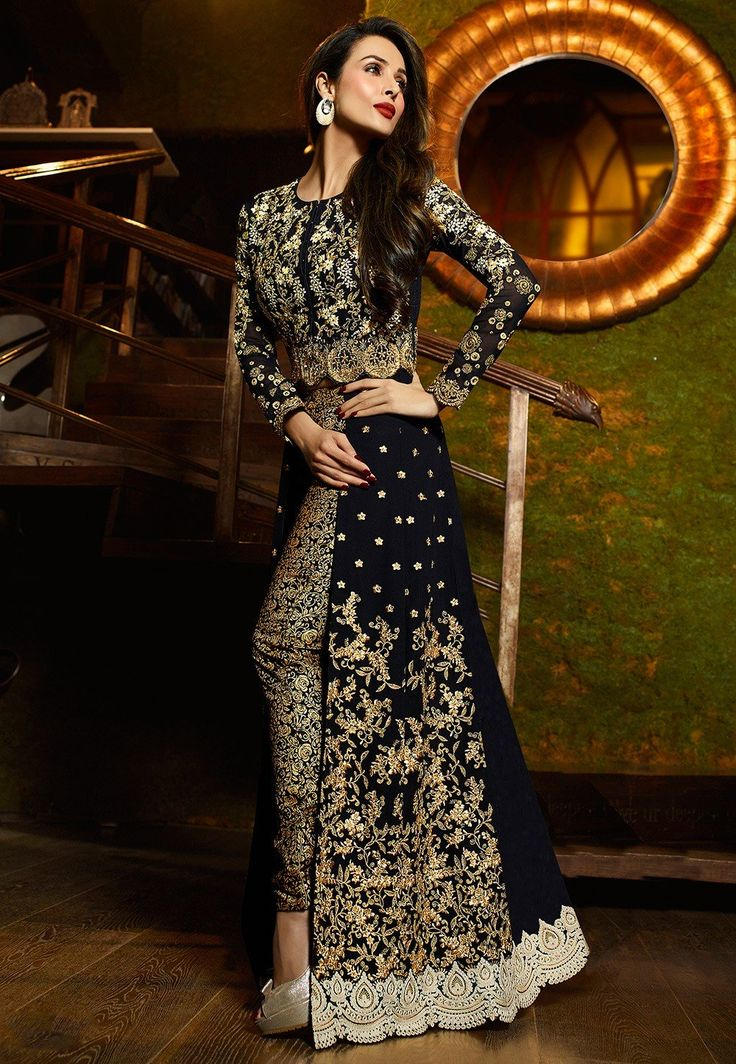 Beautifully embroidered with thread, Resham, Zari and stone in floral and foliage motifs Hemline highlighted with embroidered patch border in ornamental motifs Art Silk Jacquard straight pant and a Faux Chiffon Dupatta in black The kameez and bottom lengths are 52 and 44 inches respectively and may vary upto 2 inches Semi-stitched suit