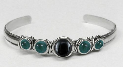 Sterling Silver Hand Made Cuff with Genuine Hematite Accented with Fluorite The Silver Dragon- Bracelets. $63.00. This Bracelet Fits a Standard Woman's Wrist. Designed And Hand- Crafted in Sterling Silver. This Unique Bracelet is Created only after Your Order Arrives. Please Allow 7-10 days for Delivery.. The Silver Dragon uses Sterling Silver that has been Reclaimed... Helping Save Mother Earth's Resources.. This Bracelet was Designed by The Silver Dragon, a Jewelr...