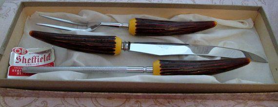"Carving Set, 1960, Sheffield Knives, Vintage Carving Knife, Bakelite Handle, Knife and Fork Set, serving utensils, turkey carving, roast set - fabulous 3 piece vintage carving set by Sheffield England .. beautiful bakelite faux horn handles and shiny stainless steel blades .. presented in original poly satin lined box- Size - Knife is 14"" long - Size - Fork is 11"" long Size - Sharpener is 12.5"" long Material - stainless steel, Bakelite  $45.00"