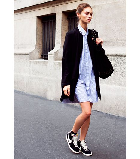 Something we love about the sneaker is its laid-back reputation. If you'd prefer to slip under the radar while wearing yours, we suggest following this street styler's lead. Go simple with a shirtdress and layer with your favorite black cardigan.