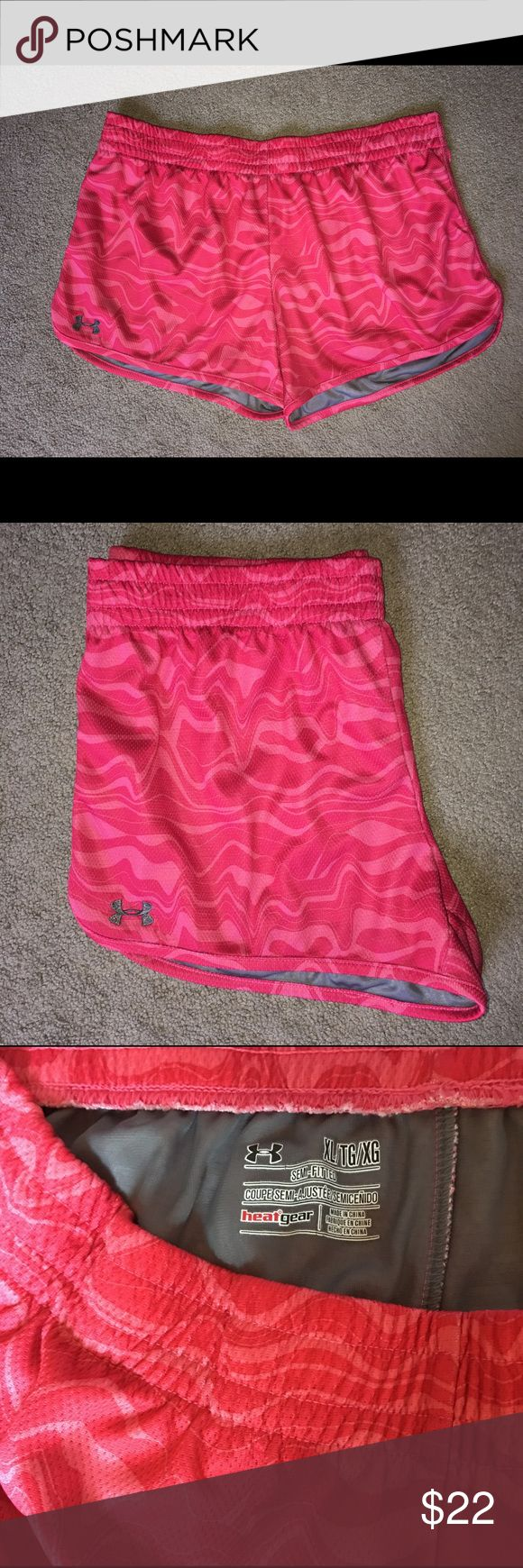 Under Armour Ladies Workout Yoga Running Shorts XL Super Cute! Gently Worn. No Flaws. In Excellent Condition. Under Armour Brand - Heatgear.  Yoga / Workout / Gym / Athletic / Running / Jogging / Casual / 70's Sexy Style Shorts. Women's / Ladies Size - Extra Large XL Colors - Red, Pink & Grey / Gray.  Please FOLLOW ME & check out the other items in my closet. BUNDLE & SAVE! I offer a discount when items are bundled & you only pay shipping one time!! Thank you & Happy Poshing! 🙏🏼❤️ Under…