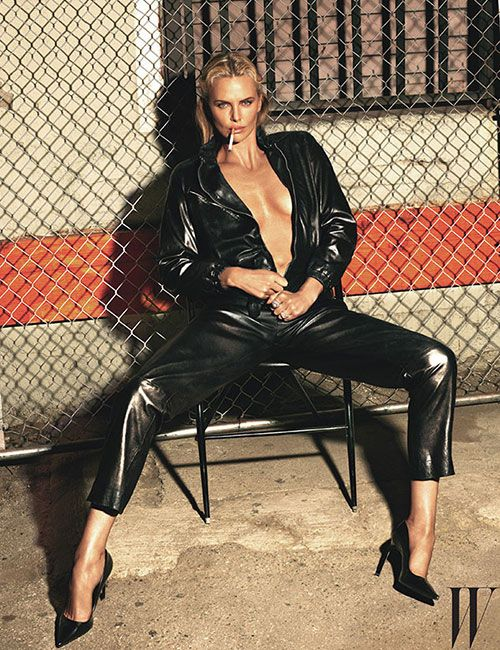 """Charlize Theron is smoking hot in a plunging jumpsuit for """"W"""" magazine."""