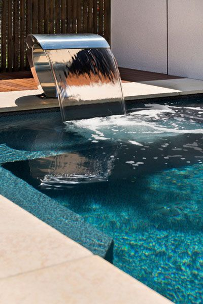 Stainless steel water curtain pool water feature on The Classique Courtyard Series small pool at the Dandenong Albatross Pools Display Centre