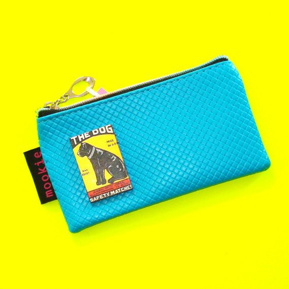 Vintage Matchbook Pouch  https://www.etsy.com/ca/listing/279862330/the-dog-deep-turquoise-vintage-matchbook