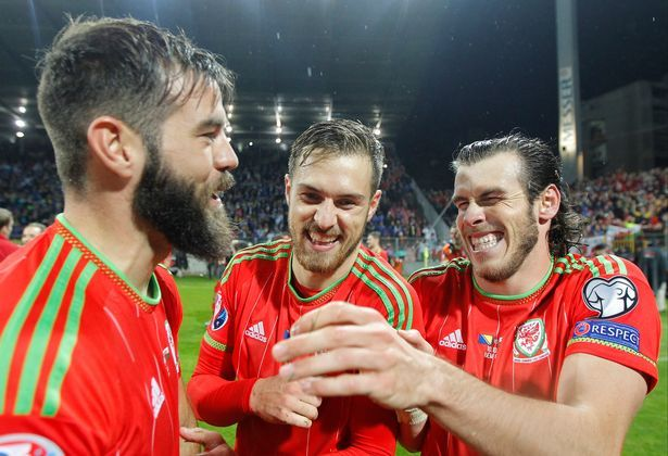 Gareth Bale, Aaron Ramsey and Joe Ledley celebrate Wales qualifying for their first tournament in more than 50 years