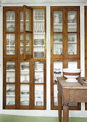 Glass fronted cupboard. Kitchen styling